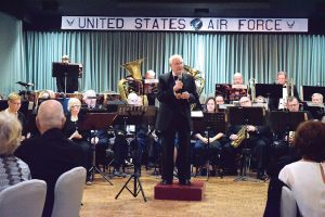 Hal Gibson leads the orchestra at Army Ball