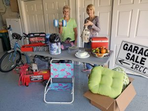 Cindy Ritter and Connie Hoodenpyle sort a few items for the much anticipated annual Community Garage Sale at Indian River Colony Club in Viera on March 7. photo by Ron Ritter.