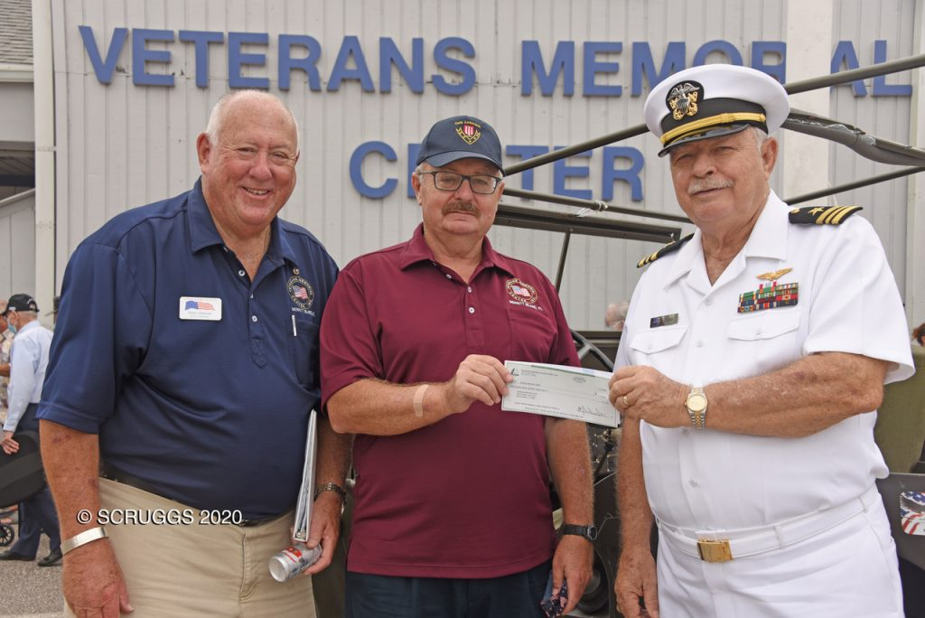 Donn Weaver (Left), Chairman of the Brevard Veterans Council and Dean Schaaf (Right), President of Brevard Veterans Memorial Center, accept a check for veterans financially impacted by COVID-19 from Brian Whalen (Center) of Indian River Colony Club. photo courtesy Brevard Veterans Council.