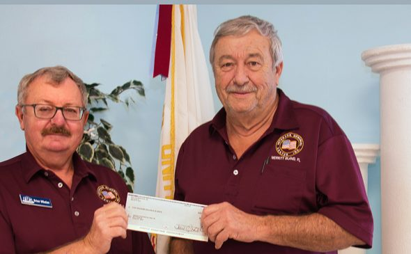 Brian Whalen (left) board member for Indian River Colony Club Foundation, presents a $5,000 donation check to Don Pearsall for Veterans Connections to a New Life. photo courtesy roger scruggs, tvphotog.com